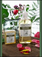Droyt soap products surrounded by leaves and flowers.