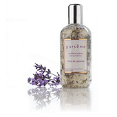 Creative product shot of Parseme bath salts with sprig of lavender.
