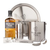 Bottle of Highland Park Scotch whisky with branded bar goods.