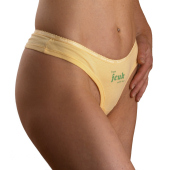 Close-up of yellow fcuk briefs worn by model.