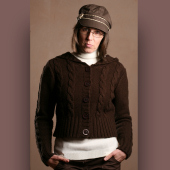 Brown jumper and hat worn by model.